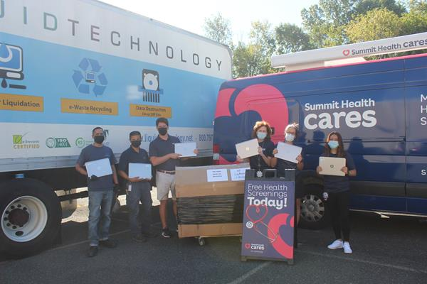 Laptops donated by Summit Health being dropped off by Liquid Technology after secure degaussing. They will be included with school supplies in Summit Health Cares' backpacks donated to New Jersey children in need.  (Pictured left to right) From Liquid Technology Bejai Lakhan, Keith Guo, Colin McNamara and from Summit Health Cares Kerry Kelly, Pamela Singer and Erica Montoya.