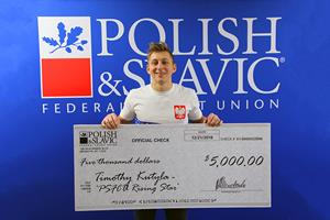 Timothy Kutyla with a check