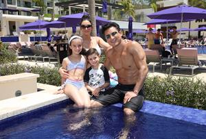 Mario Lopez sitting poolside with his family