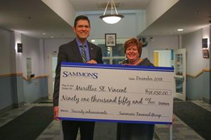 SFG presents check to Marillac St. Vincent
