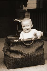 TimeSlips storytelling prompt: a carpetbag baby